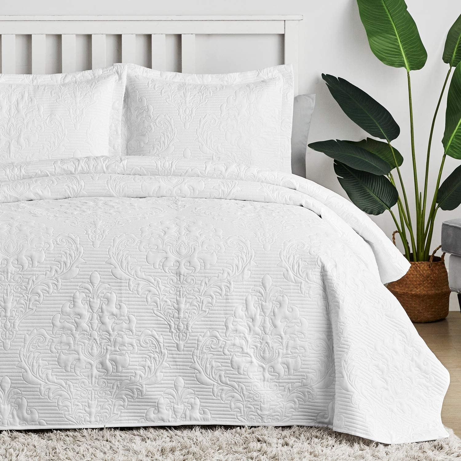 embroidered pattern in white bedding