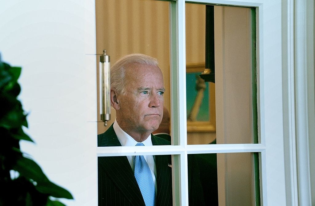 Joe Biden looking out the window of the white house