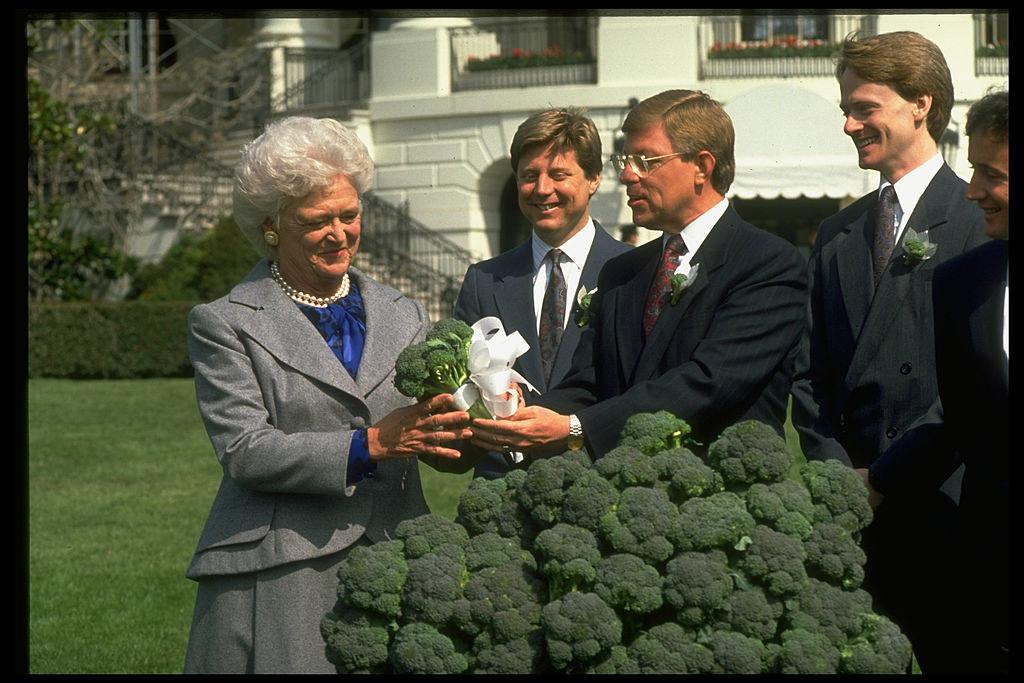 Barbara Bush inspecting the gift of broccoli