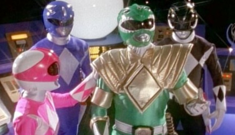 The pink, blue, green, and black rangers stand together