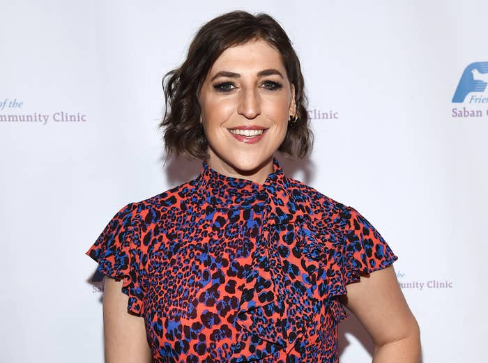 Mayim smiles while attending an event