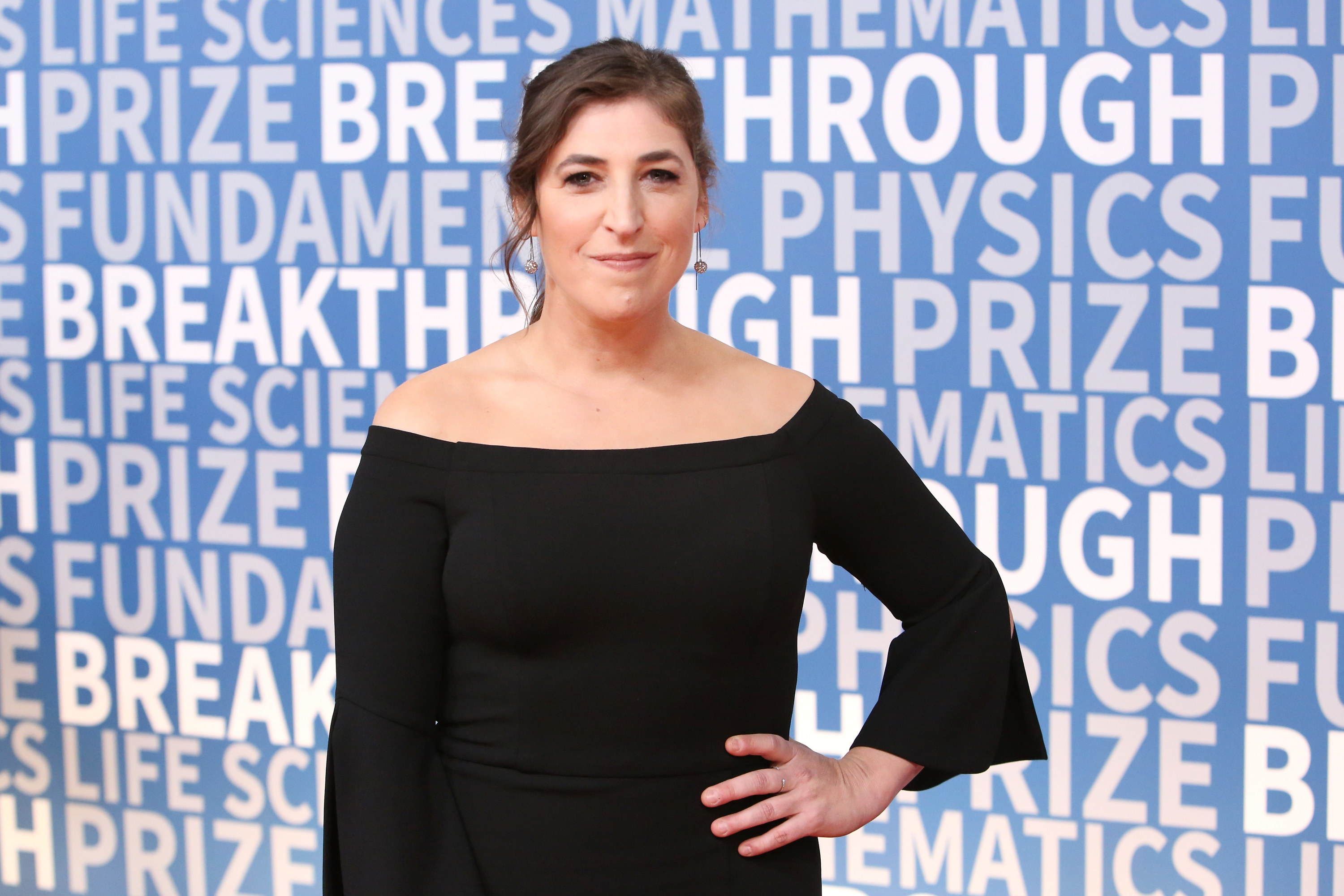 Mayim poses at an event