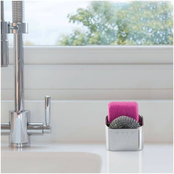 A stainless steel sponge and scrubby holder organizer