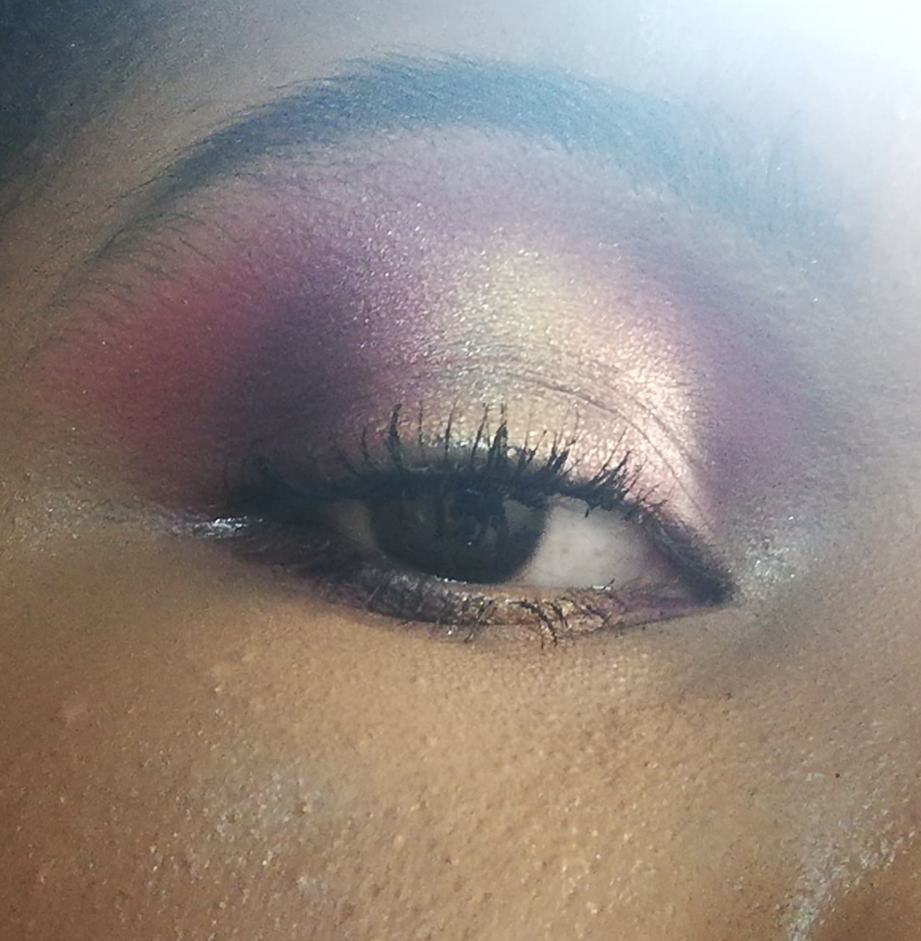 Reviewer with blend of purple and silver shadow on their eyelid