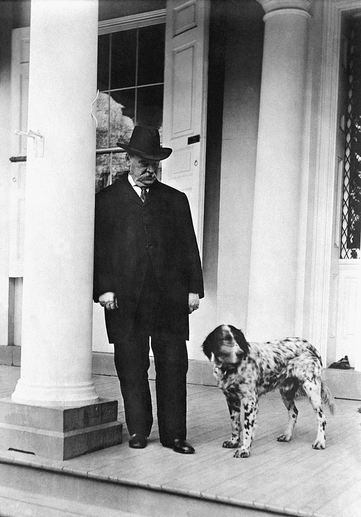 Grover Cleveland standing with his spotted dog