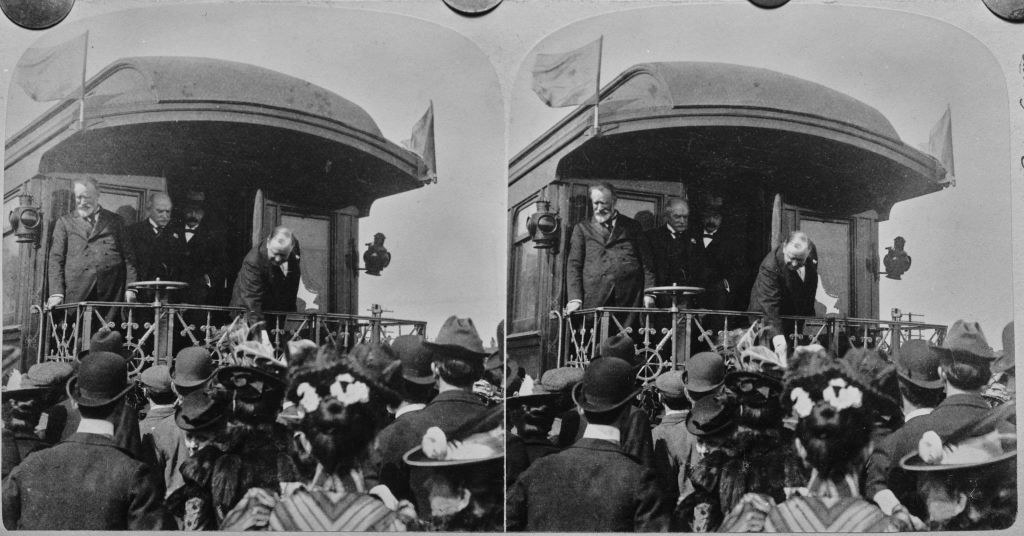 McKinley greeting people on a train