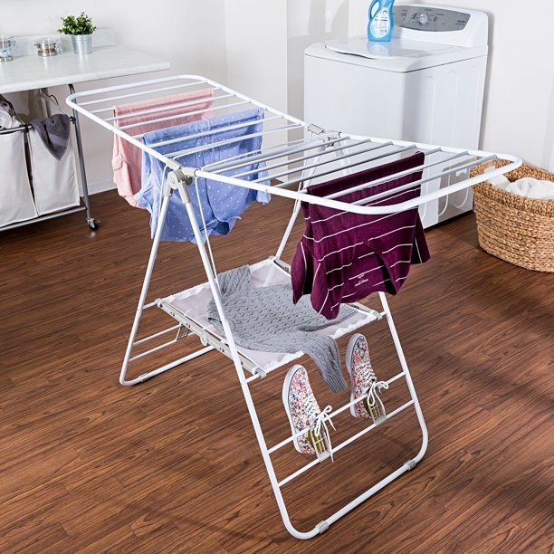 An image of a folding metal clothes drying rack