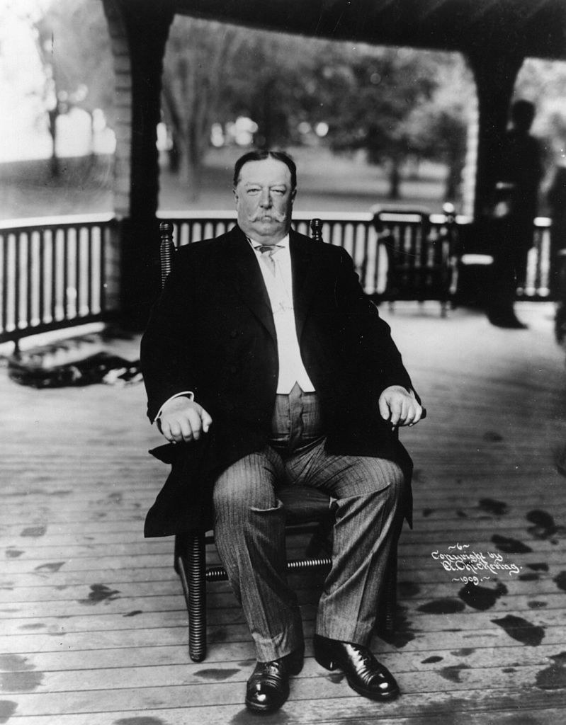 Taft sitting on his porch