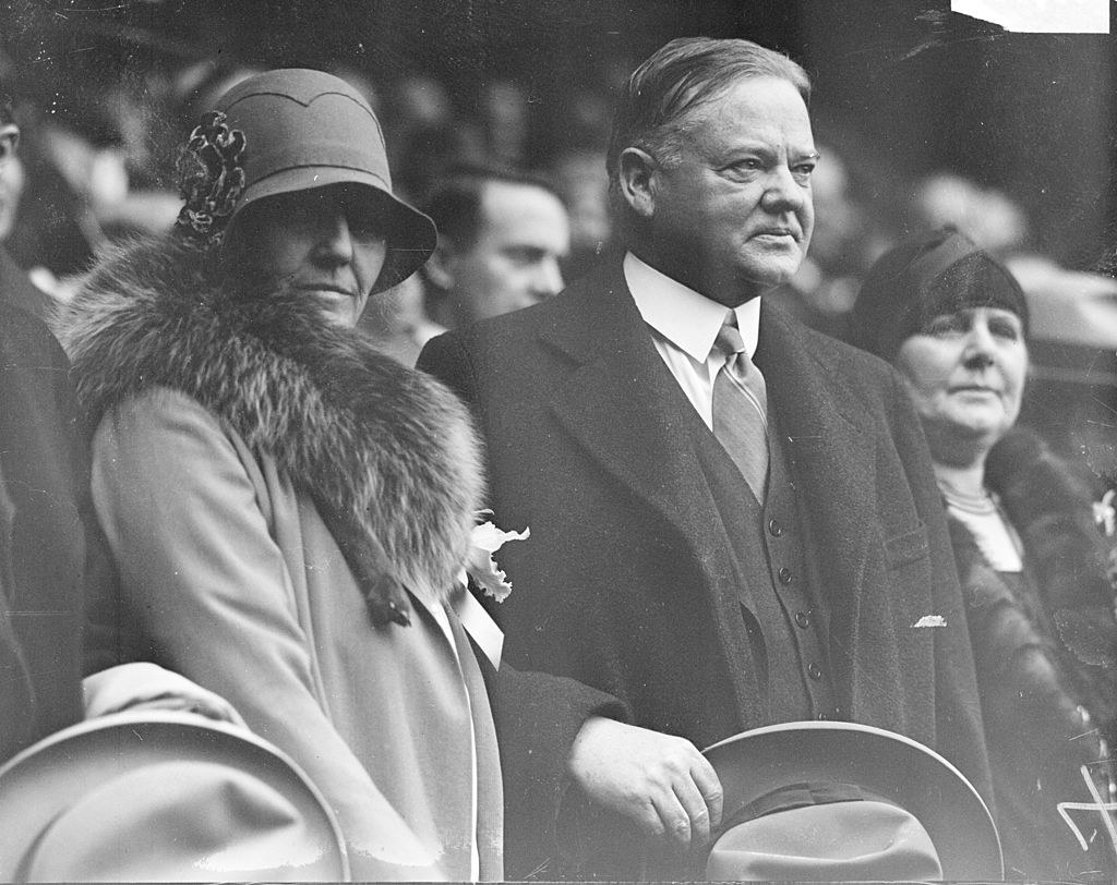 Lou Henry and Herbert Hoover standing together at an event