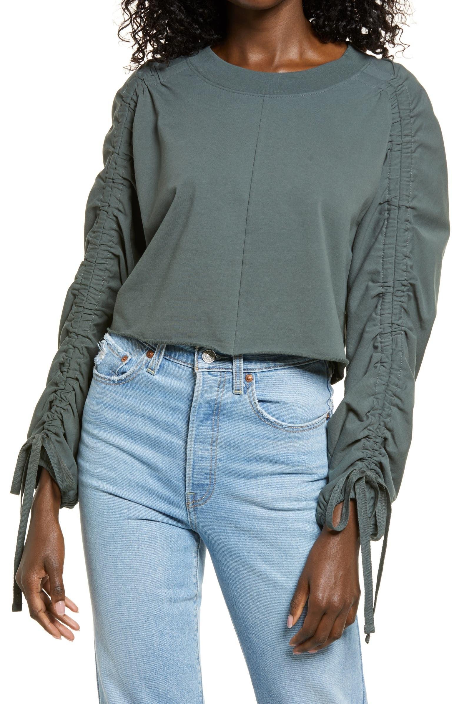 model wearing the sweatshirt in green