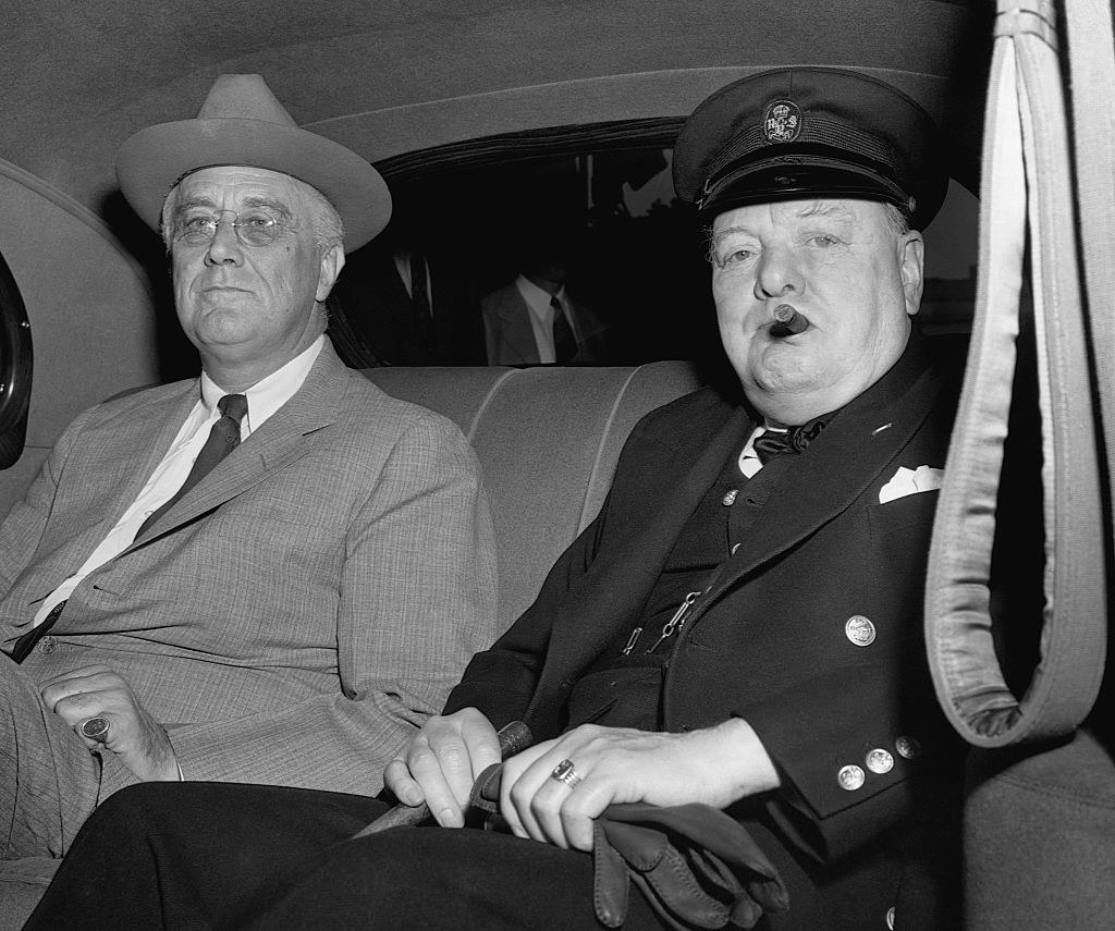 Roosevelt and Churchill in a car together, with Churchill smoking