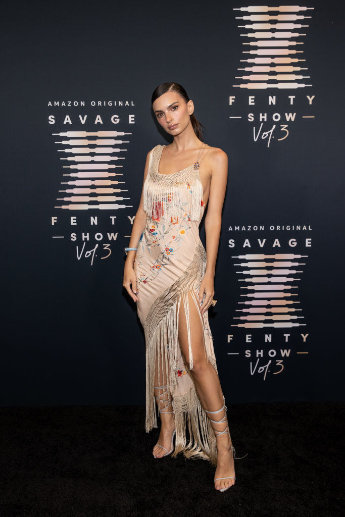 Emily wore a satin embroidered dress with fringe detailing
