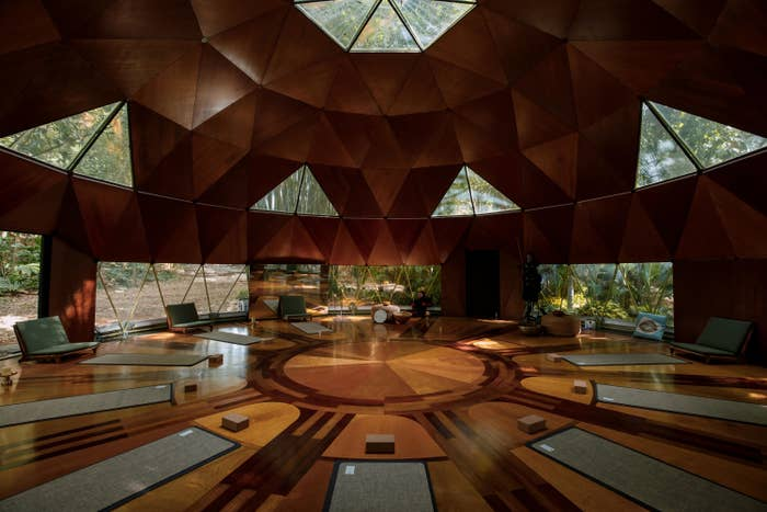 The interior features geometric shapes throughout the flooring and high cielings