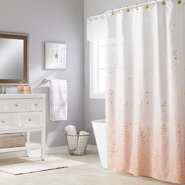 """Shower curtain shown in """"Pink"""" color in a bathroom."""