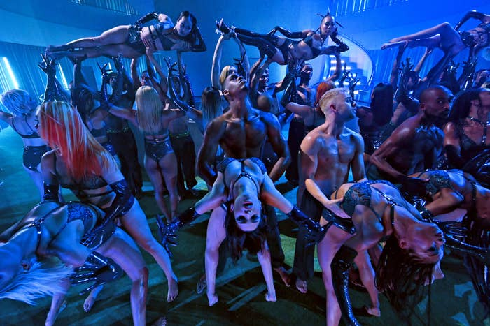 Several performance artists in lingerie dancing