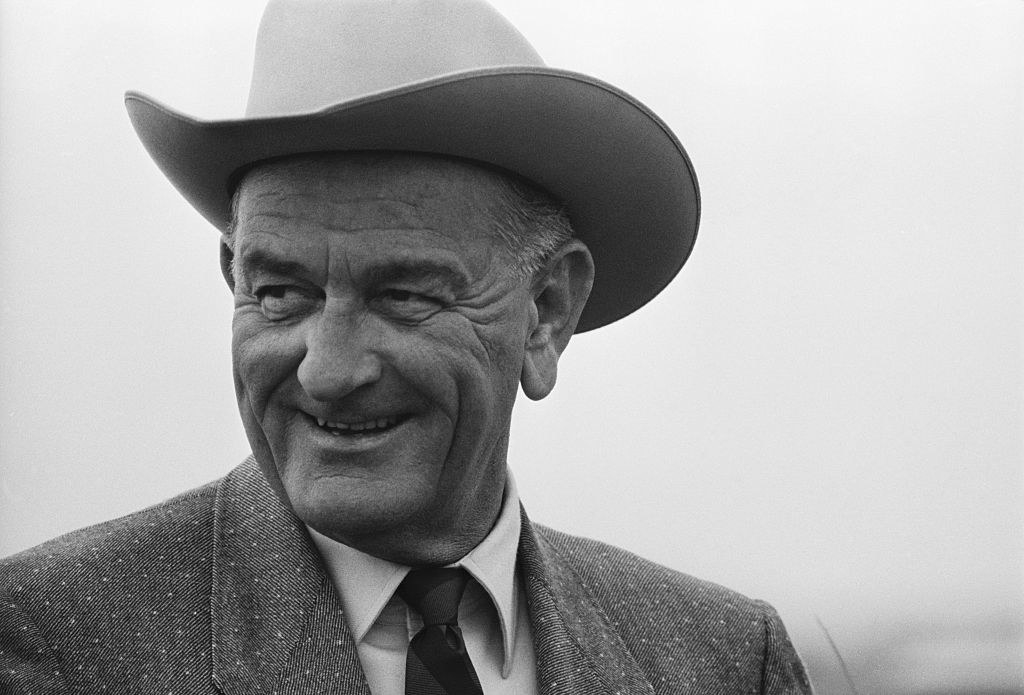 LBJ laughing in a cowboy hat