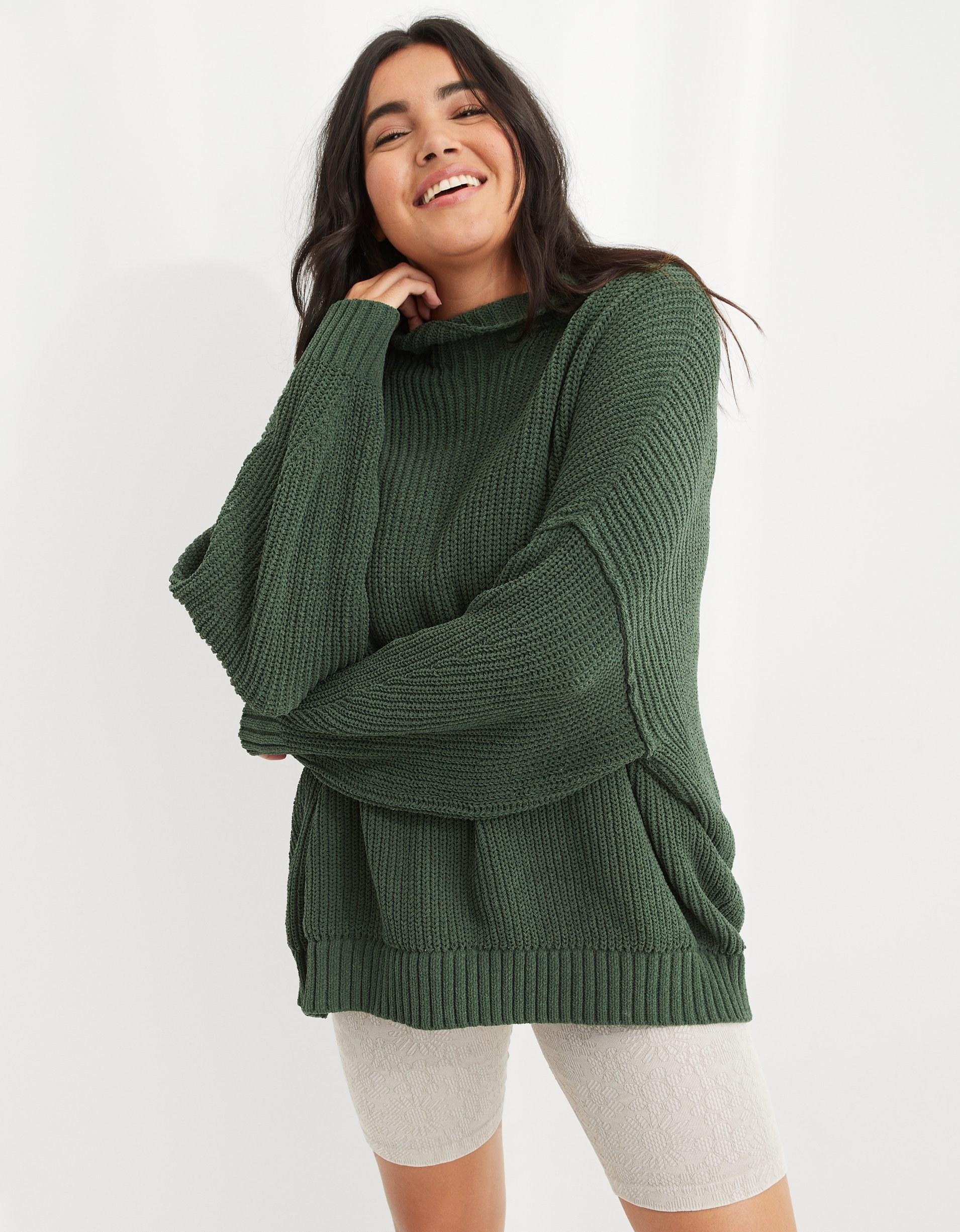 model wearing the sweater in green
