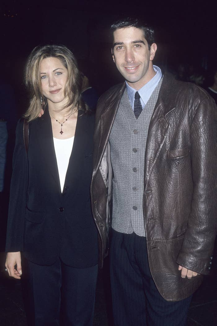 Jennifer and David standing together and wearing jackets