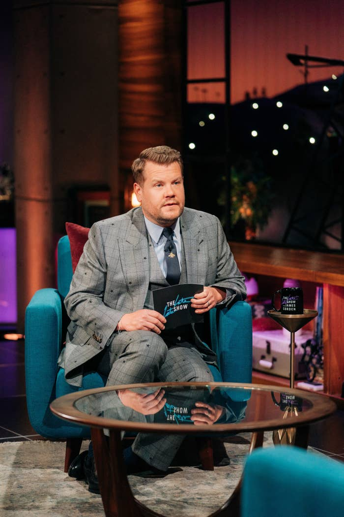 James sitting as he hosts his show