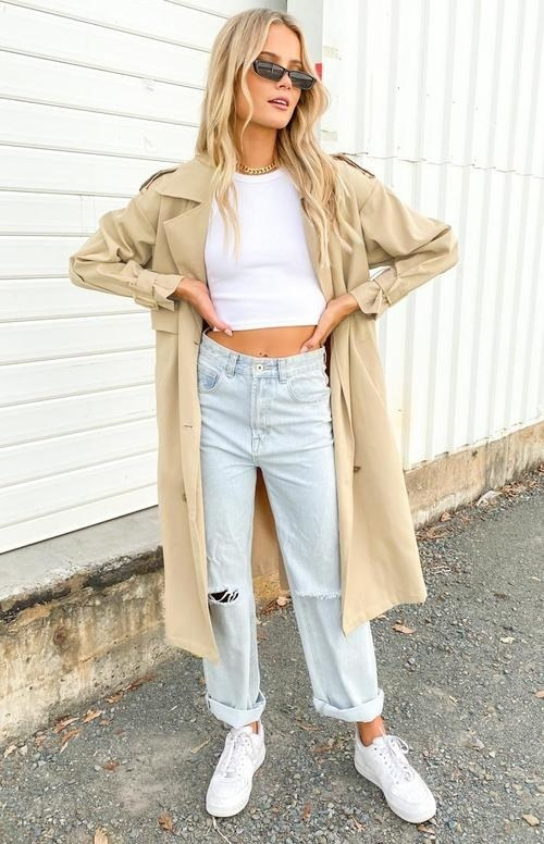 model wearing the tan trench coat