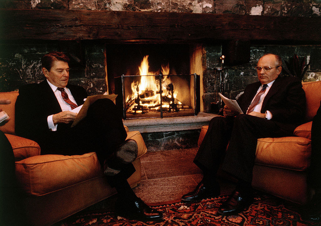 Reagan and Gorbachev chat next to a fire together