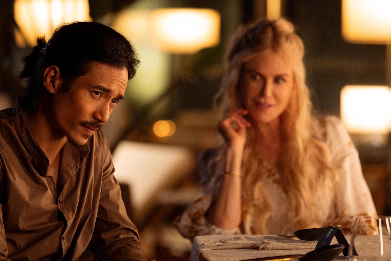 Yao looking at someone offscreen as Masha looks at him