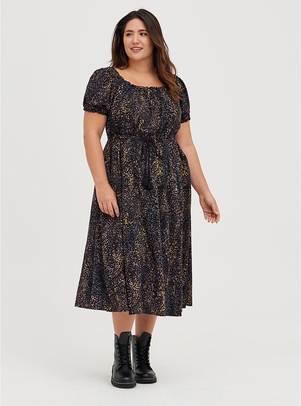model wearing the black animal-print dress