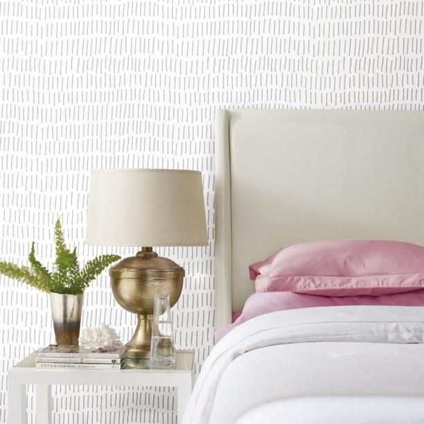 Gray tick wallpaper shown in a bedroom.