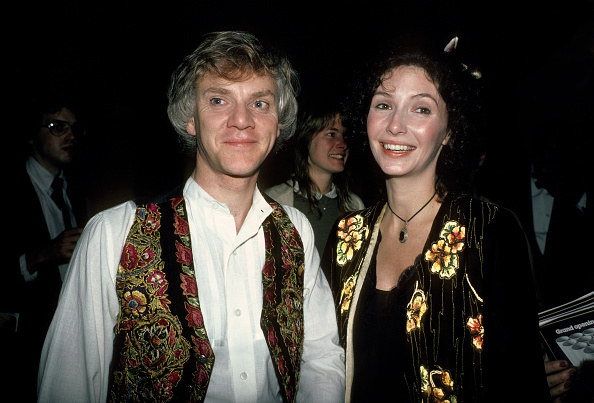 Malcolm McDowell and Mary Steenburgen pose in floral outfits