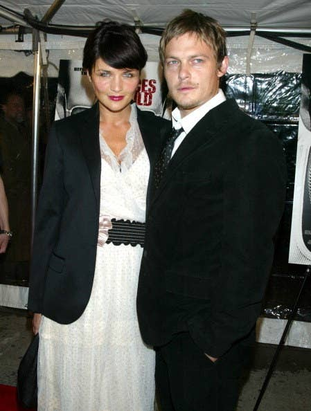 Norman Reedus and Helena Christensen smile for the camera