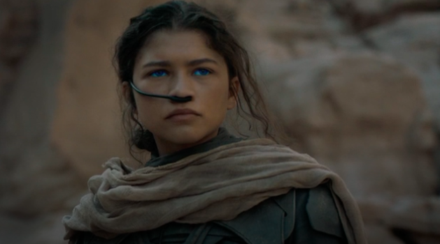 Still of Zendaya as Chani, she wears blue contacts and a black breathing apparatus called a stillsuit