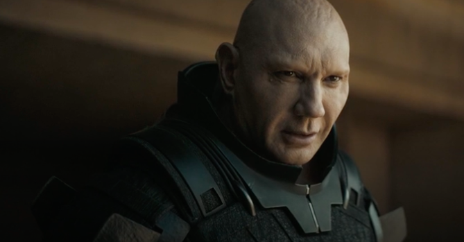 """Dave has a bald look and wears an armored outfit in a still from """"Dune"""""""