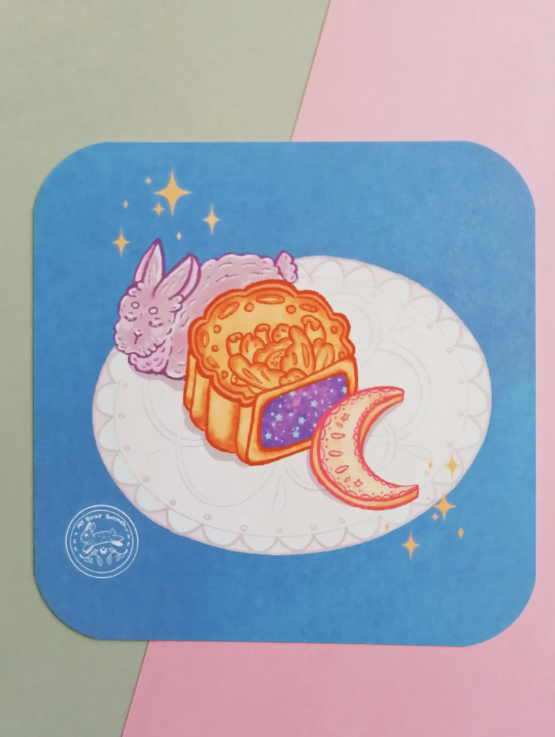 Art Print of a bunny and mooncake sitting on a white round rug