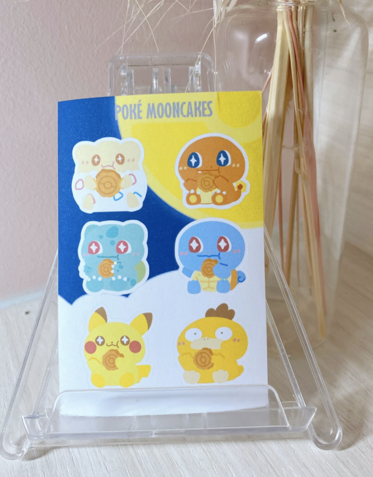 Togepi, Charmander, Bulbasaur, Squirtle, Pikachu, and Psyduck from pokemon eating mooncake