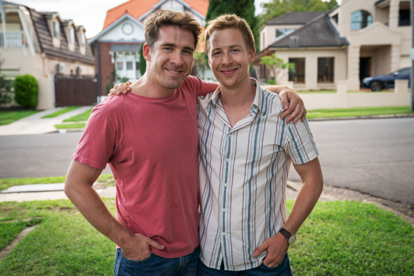 Hugh Sheridan and Angus McLaren with their arms wrapped around each other while posing for a photo