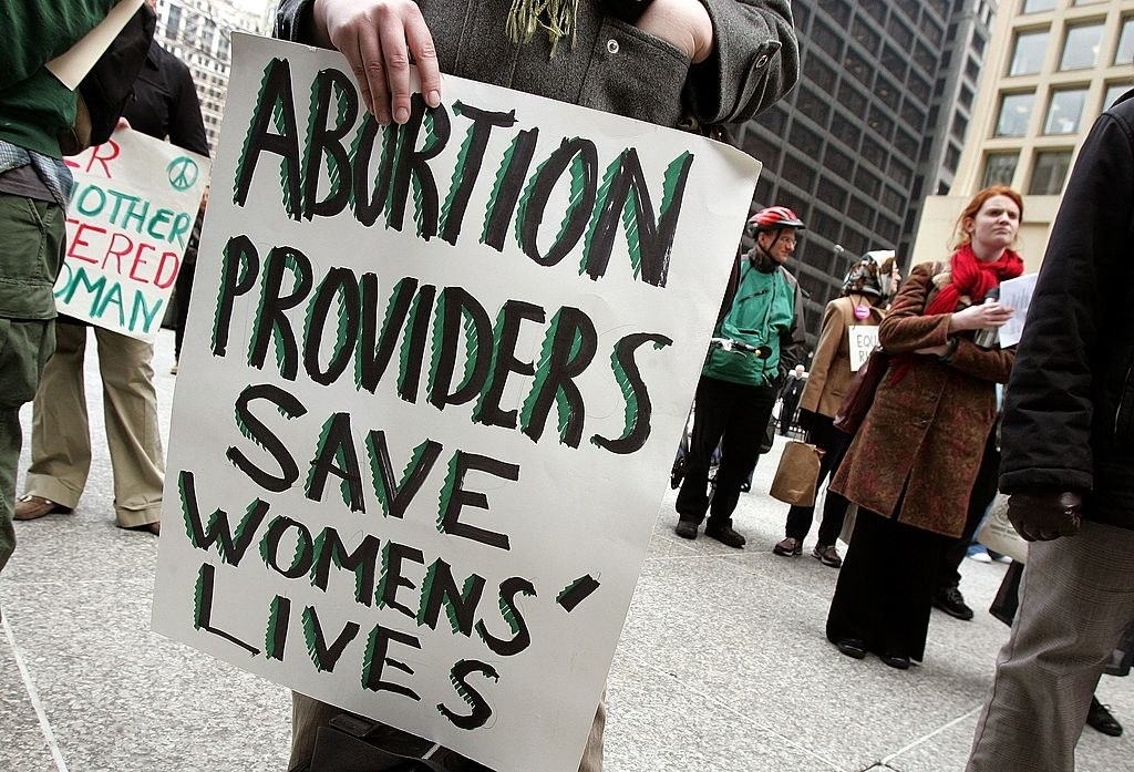 """sign saying """"abortion providers save womens' lives"""""""