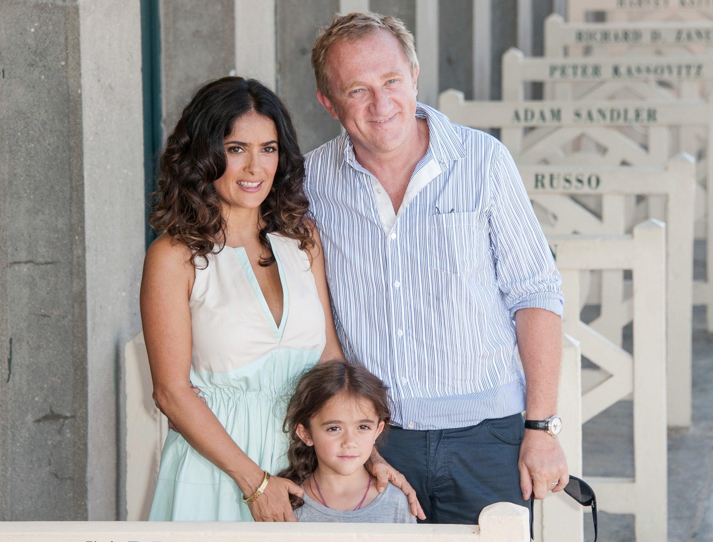 Salma and François-Henri pose with a tiny Valentina