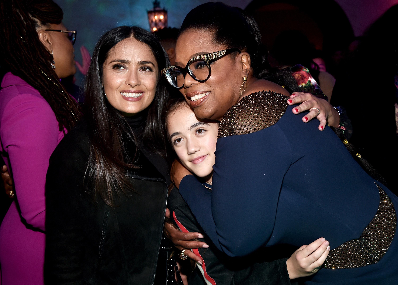 Salma and Oprah hug Valentina tight at an event