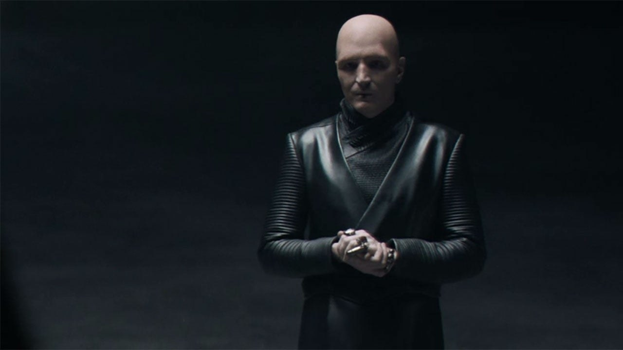 """David sports a bald look and all-black leather ensemble in a """"Dune"""" still"""
