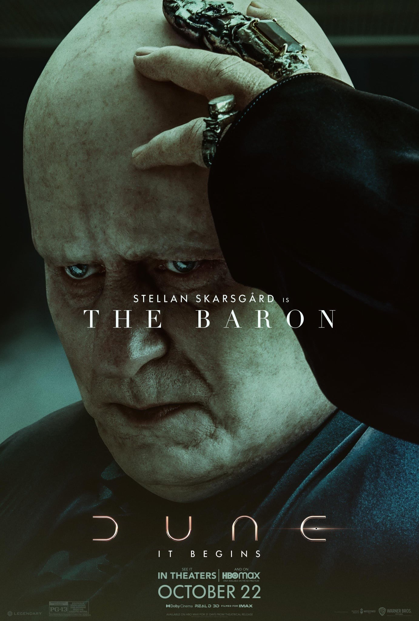"""Promotional poster for """"Dune"""" featuring the writing """"Stellan Skarsgård is The Baron,"""" """"Dune,"""" and """"It begins"""" in all capital letters, the poster also includes the release date Oct. 22 with the words """"in theaters"""" and """"HBO Max"""" in all caps"""