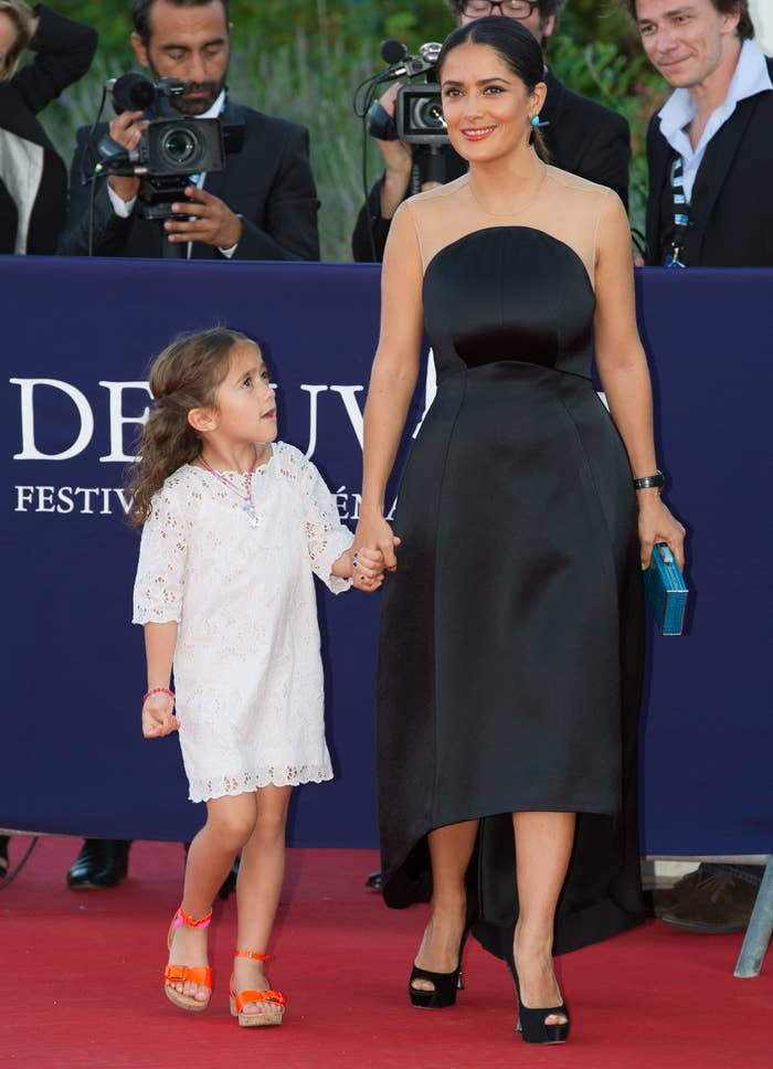 Salma holds hands with Valentina as a little girl