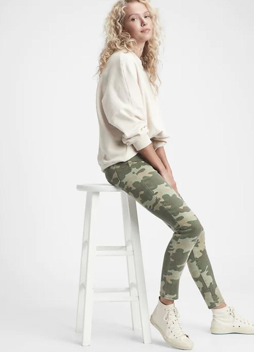 model wearing camo jeans