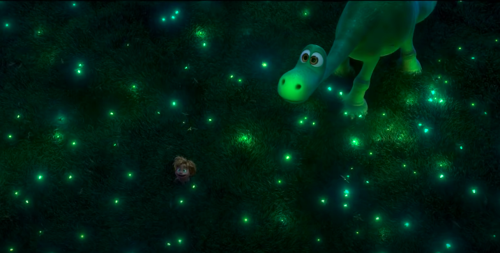 Spot and Arlo in a field surrounded by fireflies