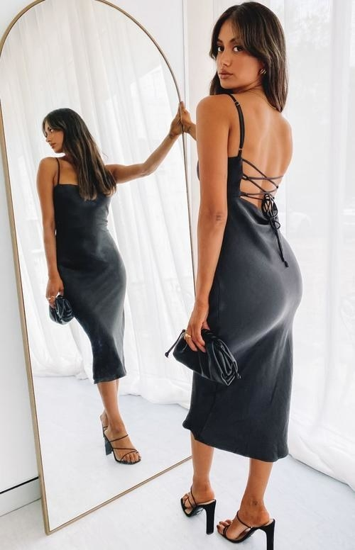 a model wearing the strappy dress