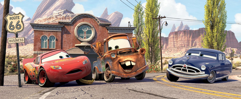 Lightening McQueen, Mater, and Doc Hudson talking