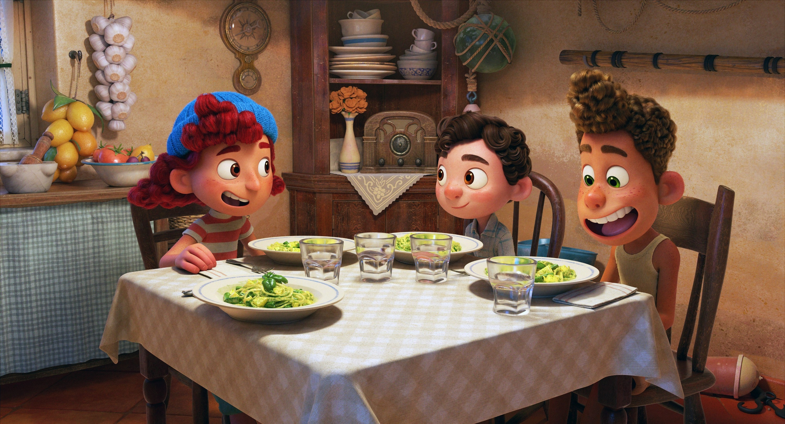 Guilia, Luca, and Alberto eating dinner together
