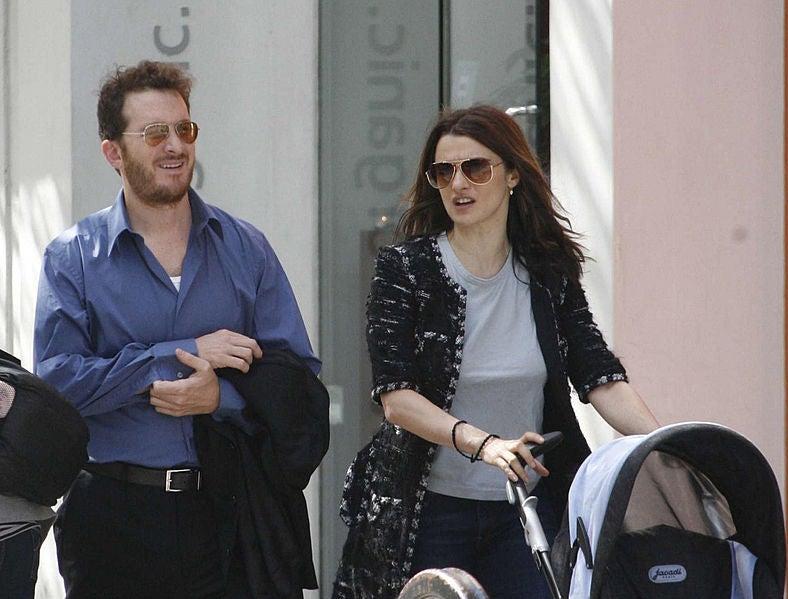 Rachel Weisz and Darren Aronofsky pushing son in stroller