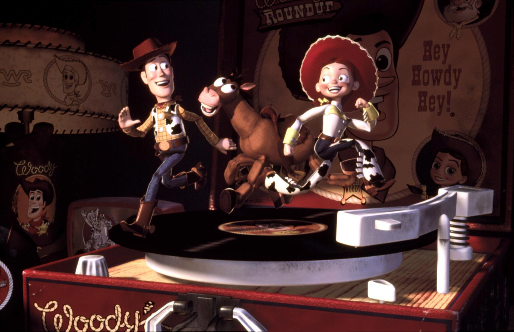 Woody, Bullseye, and Jessie the Cowgirl running on a record player