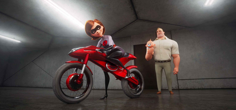 Elastigirl on her motorcycle with Mr. Incredible holding Jack Jack