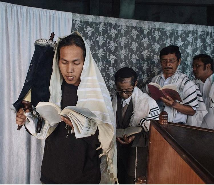 Four men praying in a Jewish temple